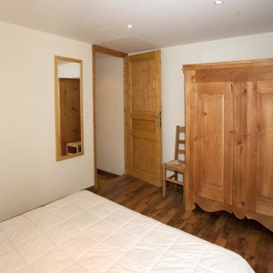 Master Double bedroom :: There is a large wardrobe in this bed room